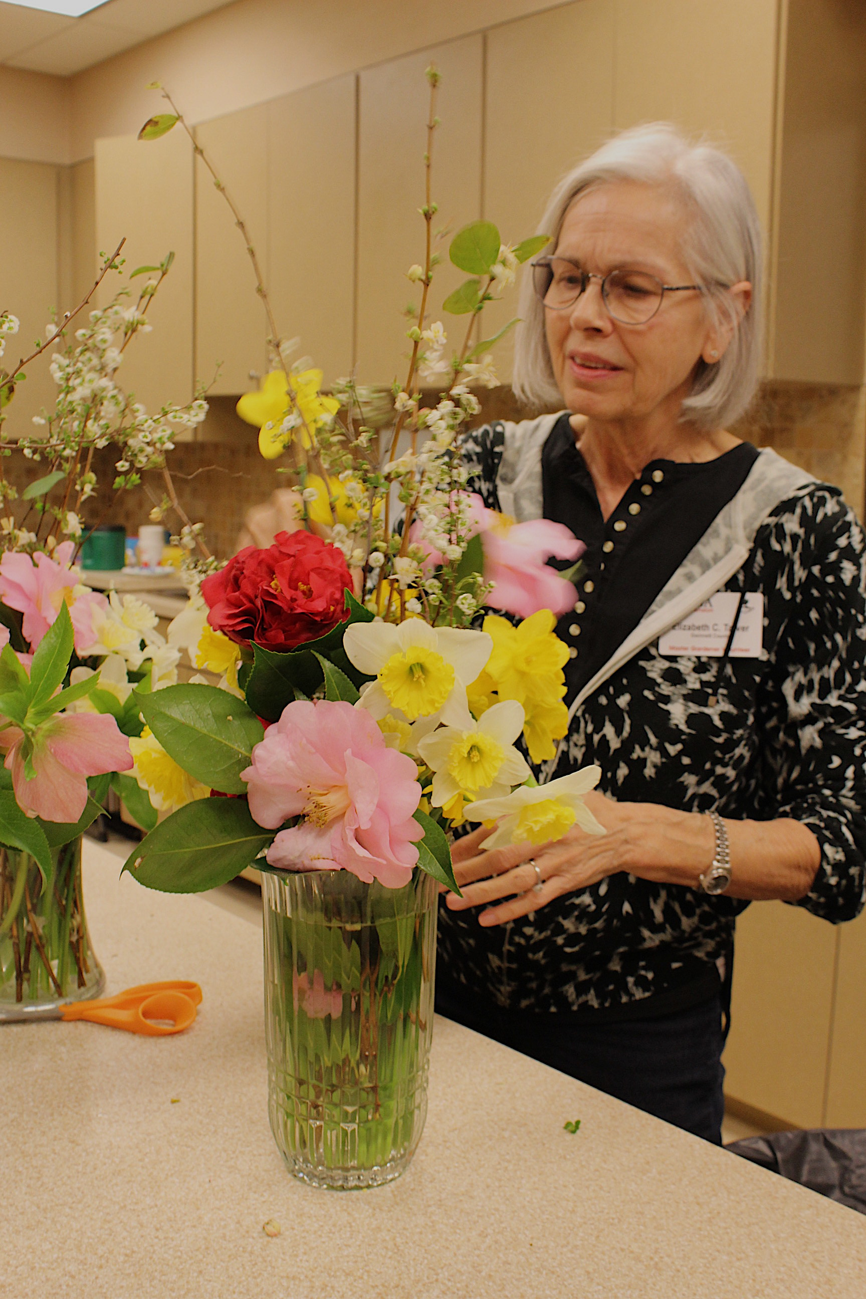 Our talented floral artist at work to grace our tables with beauty and fragrance