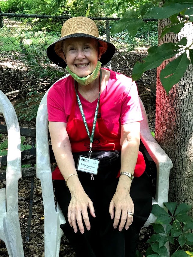 This volunteer docent is really enjoying her assignment