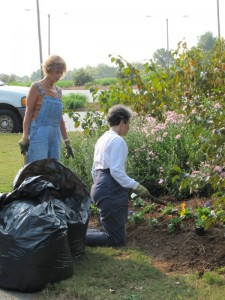 Cyndy Weber and Jean Ruder planting the front entrance